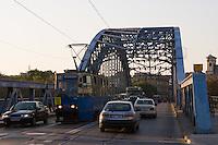 old tram seen crossing pilsudski bridge from krakow's kazimierz district to podgorze in sunshine in september 2005
