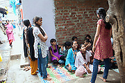 Minakshee, 17, (right) one of Mahesh Pandit's older sisters is also a Unicef community facilitator, and she is now helping to run the Unicef-run 'Deepshikha Prerika' project inside the Milind Nagar Pipeline Area, an urban slum on the outskirts of Mumbai, Maharashtra, India, where she resides with her family.