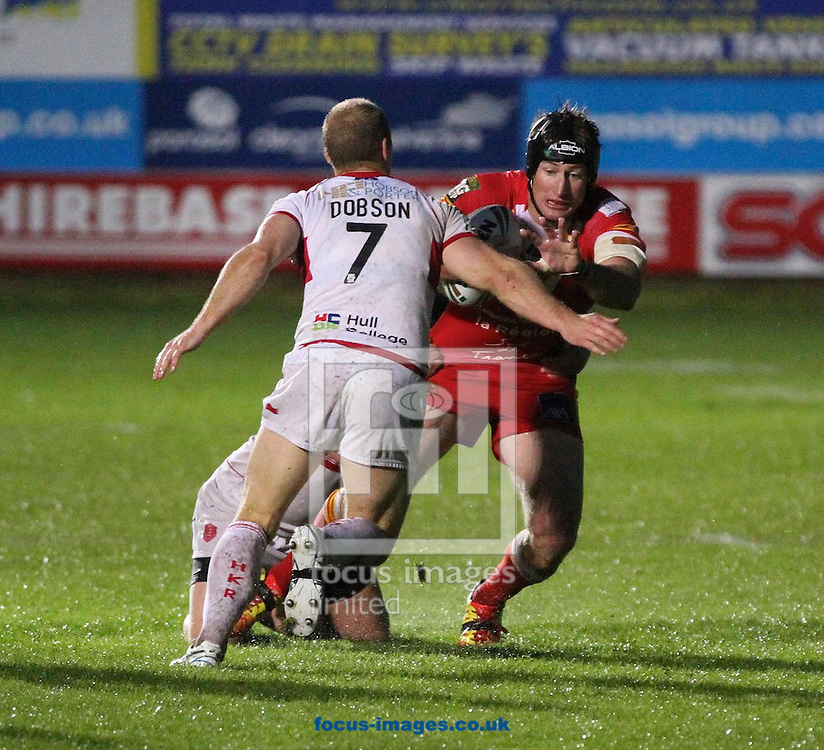 Picture by Richard Gould/Focus Images Ltd. 07710 761829.22/06/12.Micheal Dobson of Hull KR trys to stop Steve Mezies of Catalan Dragons during the Stobart Super League match at New Craven Park, Hull.