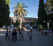 People in the evening by the Ayuntamiento City Hall building built in 1734 Ronda, Malaga province, Spain