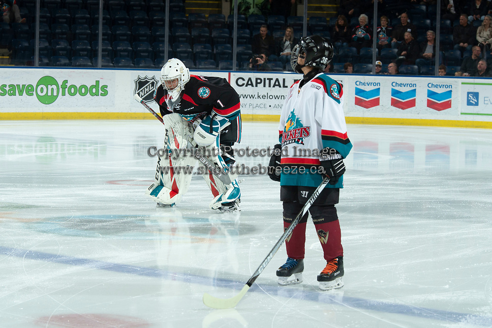 KELOWNA, CANADA - DECEMBER 5:  James Porter #1 of the Kelowna Rockets skates to the blue line as the Pepsi player looks on prior to the national anthem against the Tri-City Americans on December 5, 2018 at Prospera Place in Kelowna, British Columbia, Canada.  (Photo by Marissa Baecker/Shoot the Breeze)