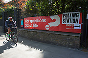 London, UK. Thursday 7th May 2015. Voters attending a polling station at St Pauls Institute in the constituency of  Poplar and Limehouse in East London on the day of the general election. This is a Labour Party seat, although this electin is set to be one of the most hotly contested in a generation.