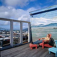 The historic hotel Elliott in Astoria Oregon offers a lovely rooftop deck where patrons and guests can enjoy relaxing in the afternoon sun or having a glass of wine from the bar.  The deck offers panoramic views of the Astoria area, including the Columbia River and the Astoria-Megler Bridge, a 4.1 mile long bridge that connects Oregon and Washington states.