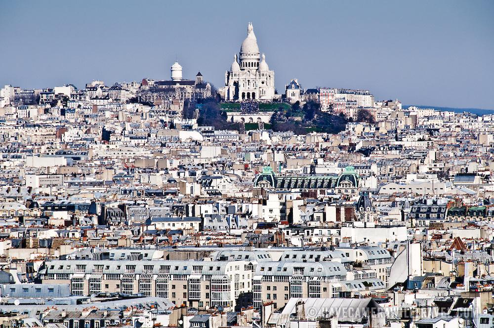 Basilique du Sacré-Coeur in Paris amongst the buildings of Montmartre. View from top of Notre Dame Cathedral