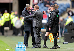 Heart of Midlothian's manager, Craig Levein (left) speaks with Celtic's manager, Brendan Rodgers at the final whistle of the Betfred Cup semi final match at BT Murrayfield Stadium, Edinburgh.
