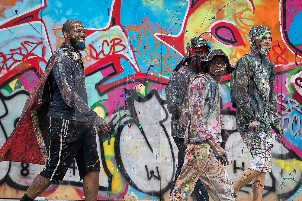 © Licensed to London News Pictures. 26/08/2018. London, UK. Carnival goers covered in paint enjoy family day of the 2018 Notting Hill Carnival. Up to 1 million people are expected to attend this weekend's event that is one of the worlds largest street festivals. Photo credit: Ben Cawthra/LNP