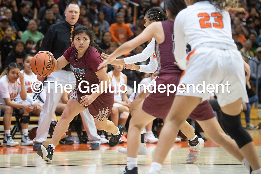 Shiprock Chieftain Sanaa Keeswood (33) drives to the basket in their district 1-4A championship game against the Gallup Bengals Saturday night at Gallup High School in Gallup. The Bengals beat the Chieftains 72-57.