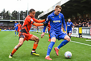 AFC Wimbledon Forward Joe Pigott (39) and Wycombe Wanderers Midfielder Curtis Thompson (18) battle for the ball during the EFL Sky Bet League 1 match between AFC Wimbledon and Wycombe Wanderers at the Cherry Red Records Stadium, Kingston, England on 27 April 2019.