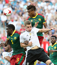 June 26, 2017 - Sochi, Russia - MATTHIAS GINTER (C) of Germany competes for a header with MICHAEL NGADEU-NGADJUI (L) and ADOLPHE TEIKEU (top) during the group B match between Germany and Cameroon of the 2017 FIFA Confederations Cup. Germany won 3-1. (Credit Image: © Xu Zijian/Xinhua via ZUMA Wire)