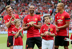 Manchester United's Darren Fletcher (left), Rio Ferdinand (centre) and Wes Brown (right) have a joke before Michael Carrick's Testimonial match at Old Trafford, Manchester.