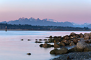 Earth's shadow and the Golden Ears (Mount Blanshard) after sunset.  Photographed from Blackie Spit at Crescent Beach, Surrey, British Columbia, Canada