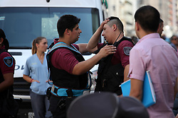 February 6, 2018 - Buenos Aires, Buenos Aires, Argentina - Six shot wounded during downtown shooting, when a group of criminals attempted to steal a jewelry store and was discovered by the police. More than 50 shots, including machine gun fire and a wounded judge was what left the shooting in broad daylight in downtown (Credit Image: © Claudio Santisteban via ZUMA Wire)