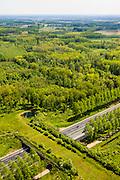 Nederland, Noord-Brabant, Gemeente Boxtel, 27-05-2013; De Scheeken, ten westen van Sint-Oedenrode. A2 met ecoduct, Natuurbrug Het Groene Woud.<br /> Ruilverkaveling De Scheeken maakt deel uit van het Nationale Landschap het Groene Woud. Het gebied was voor de ruilverkaveling sterk versnipperd en kende een gebrekkige ontwatering. Ruilverkaveling uitgevoerd in de jaren veertig van de vorige eeuw, wederopbouwperiode. Het onderliggende landschapsplan hield rekening met streekeigen karakter van het cultuurlandschap.<br /> Motorway A2 and wildlife bridge throught the National Landscape Groene Woud (Green Forest). The area was fragmented before land consolidation and had a poor drainage. Land consolidation took place in the forties of the last century, reconstruction period. The landscape plan took into account the typical local character of the landscape.<br /> luchtfoto (toeslag op standard tarieven)<br /> aerial photo (additional fee required)<br /> copyright foto/photo Siebe Swart