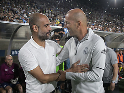 July 26, 2017 - Los Angeles, California, U.S - Coach, Zinedine Zidane of Real Madrid greets Pep Guardiola of Manchester City prior to the start of their International Champions Cup game at the Los Angeles Memorial Coliseum in Los Angeles, California on Wednesday July 26, 2017. Manchester City defeats Real Madrid, 4-1. (Credit Image: © Prensa Internacional via ZUMA Wire)
