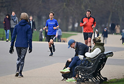 © Licensed to London News Pictures. 08/03/2021. London, UK. Members of the public exercise in Hyde Park central London, on the day the lockdown restrictions are eased. From today (Monday) some rules have been relaxed, including children returning to school. Photo credit: Ben Cawthra/LNP