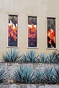 Decorative stained glass windows at the Casa Siete Leguas, El Centenario tequila distillery in Atotonilco de Alto, Jalisco, Mexico. The Seven Leagues tequila distillery is the oldest family owned distillery producing authentic handcrafted tequila using traditional methods.