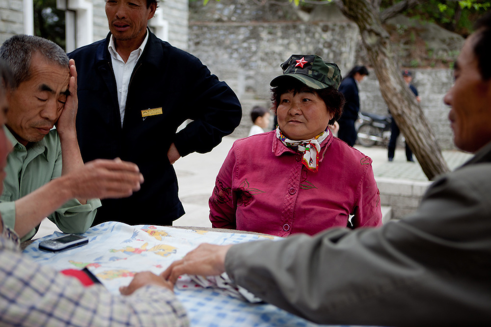 Villagers playing cards close to the entrance of The Mutianyu Great Wall. Mutianyu is a section of the Great Wall of China located in Huairou County 70km northeast of Beijing. The Mutianyu section of the Great Wall is connected with Jiankou in the west and Lianhuachi in the east. As one of the best-preserved parts of the Great Wall, the Mutianyu section of the Great Wall used to serve as the northern barrier defending the capital and the imperial tombs.
