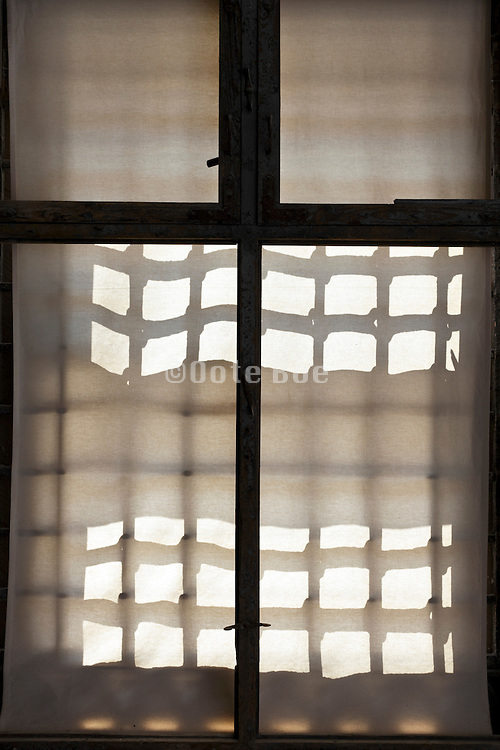 strong sunlight projection on curtain in window