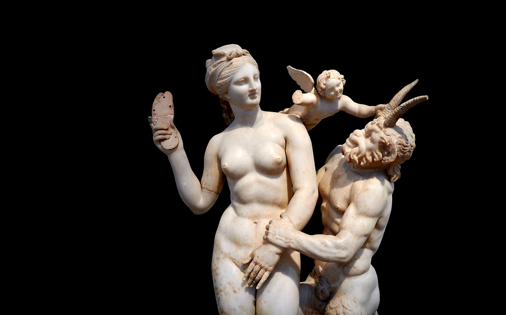 Hellenstic marble statue group of Aphrodite (Venus) with Pan and Eros, Circa 100 BC, House of Poseidonaistai of Beryttos, Delos, Athens National Archaeological Museum.  Cat no 3335. Against black<br /> <br /> The nude goddess Aphrodite (Venus) attempte to fend off goat footed Pan who make erotic advances towards her. Aphrodite holds a sandal in her right hand threatening Pan while the winged god Eros comes to her aid. According to an inscription on the statues base it was dedicated to Dionysus of Beryttos (Beirut) to hai ancestral gods. .<br /> <br /> If you prefer to buy from our ALAMY STOCK LIBRARY page at https://www.alamy.com/portfolio/paul-williams-funkystock/greco-roman-sculptures.html . Type -    Athens    - into LOWER SEARCH WITHIN GALLERY box - Refine search by adding a subject, place, background colour, etc.<br /> <br /> Visit our ROMAN WORLD PHOTO COLLECTIONS for more photos to download or buy as wall art prints https://funkystock.photoshelter.com/gallery-collection/The-Romans-Art-Artefacts-Antiquities-Historic-Sites-Pictures-Images/C0000r2uLJJo9_s0