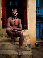 Varanasi, INDIA - CIRCA NOVEMBER 2018: Portrait of Kushti Wrestler in the Tulsi akhara of Varanasi. Varanasi is the spiritual capital of India, the holiest of the seven sacred cities and with that many rituals and offerings are performed daily by priests and hindus.