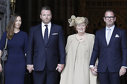 © Licensed to London News Pictures. 27/09/2016.  The family of Sir Terry Wogan , including his widow Lady Helen Wogan, stand at the West Door of Westminster Abbey after attending a Service of Thanksgiving for the Life and Work of Sir Terry Wogan . Veteran broadcaster Sir Terry Wogan died in January 2016. The Irish star had a long and successful career at the BBC, including stints on  radio and TV. London, UK. Photo credit: Peter Macdiarmid/LNP