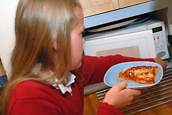 girl heats up her microwave meal