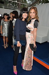 Left to right, CLAUDIA WINKLEMAN and MYLEENE KLASS at the Glamour Women of The Year Awards in Association with Next held in Berkeley Square Gardens, Berkeley Square, London on 3rd June 2014.