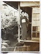 woman portrait with traditional Japanese house 1930s