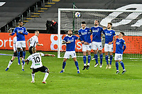 Football - 2020 / 2021 Sky Bet Championship - Swansea City vs Cardiff City - Liberty Stadium<br /> <br /> André Ayew Swansea City shoots at goal from a free kickin the South Wales local derby match<br /> <br /> COLORSPORT/WINSTON BYNORTH