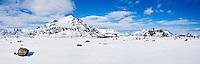Justadtind mountain peak rises in distance in winter, near Stamsund, Vestvågøy, Lofoten Islands, Norway
