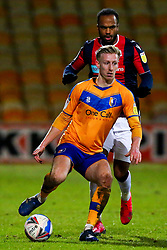 Harry Charsley of Mansfield Town looks for options under pressure from Nathan Delfouneso of Bolton Wanderers - Mandatory by-line: Ryan Crockett/JMP - 17/02/2021 - FOOTBALL - One Call Stadium - Mansfield, England - Mansfield Town v Bolton Wanderers - Sky Bet League Two