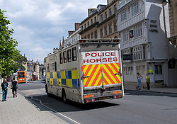 © Licensed to London News Pictures. 09/06/2020. Oxford, UK. Vehicles carrying police horses arrive in Oxford where a demo will be held later by campaigners calling for the removal of a statue of controversial imperialist Cecil Rhodes from Oriel College at Oxford University. Black Lives Matter protesters recently pulled down a statue of slave trader Edward Colston in nearby Bristol Town centre, following the death of George Floyd in the U.S.A . Photo credit: Ben Cawthra/LNP