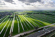Nederland, Zuid-Holland, Stompwijk, 23-10-2013; A4 tussen Leiden en Leidschendam, zicht op het Groene Hart met windturbines en poldermolen.<br /> Motorway A4 and green polder in the West of the netherlands, the Green Heart.<br /> luchtfoto (toeslag op standaard tarieven);<br /> aerial photo (additional fee required);<br /> copyright foto/photo Siebe Swart.