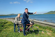 REPRO FREE: 20-6-2014: €3.4m greenway for South Kerry.<br /> Mary o'Connor from Waterville gives her son-in-law, Junior Transport Minister Alan Kelly a friendly push off after he turned the first sod for Phase 1 of the South Kerry Greenway project at Mannix Point, Cahersiveen, County Kerry on Friday surrounded by members of Kerry County Council, ACARD and local politicians.<br /> The South Kerry Greenway will facilitate walkers and cyclists and stretch 26 kilometres from Glenbeigh to Caherciveen and Renard and will be routed along the old railway line. The route includes travelling through train tunnels, crossing over the magnificient Gleesk Viaduct all along the Wild Atlantic Way with the most spectacular scenery in Ireland overlooking Dingle Bay.<br /> Picture by Don MacMonagle<br /> <br /> FREE REPRO