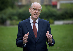 © Licensed to London News Pictures. 12/08/2021. London, UK. Education minister NICK GIBB is seen during a media interview in Westminster, London on the morning that GCSE exam results are released. Photo credit: Ben Cawthra/LNP