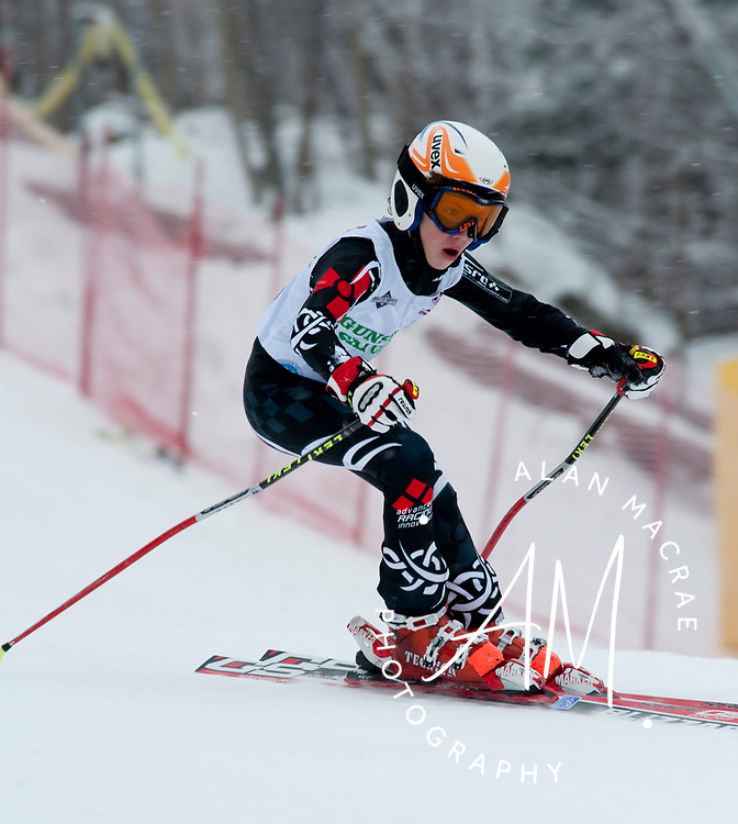 Zane Zimmerman, grandson of Olympian Penny Pitou, makes his way down the mountain in the annual Gus Pitou Memorial Ski Races at Gunstock on New Year's Day, January 1, 2010.  (Alan MacRae/for the Citizen)