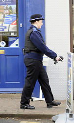 © Licensed to London News Pictures. 19/11/2012. Chislehurst, UK. A PCSO on patrol in Chislehurst town centre on November 19, 2012. An entire safer neighbourhood team from the Mottingham and Chislehurst Metropolitan police team  has been sacked after an internal investigation found some of the officers had been playing backgammon and poker, watching television and cleaning golf clubs while on duty. The disciplinary action followed an undercover operation by the Metropolitan Police Service's (MPS) Directorate of Professional Standards in 2010. Photo credit : Grant Falvey/LNP