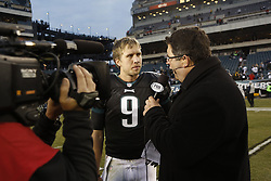 Philadelphia Eagles quarterback Nick Foles #9 is intervened by Tony Siragusa of Fox Sports after the NFL game between the Arizona Cardinals and the Philadelphia Eagles on Sunday, December 1st 2013 in Philadelphia. The Eagles won 24-21. (Photo by Brian Garfinkel)