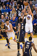 Golden State Warriors guard Klay Thompson (11) shoots a jumper against the Indiana Pacers at Oracle Arena in Oakland, Calif., on December 5, 2016. (Stan Olszewski/Special to S.F. Examiner)