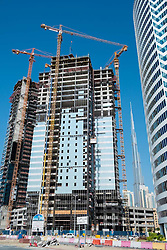New high-rise office towers under construction at new Business Bay commercial and residential area in Dubai United Arab Emirates