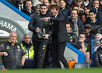 Football - 2016 / 2017 Premier League - Chelsea vs. Arsenal <br /> <br /> Chelsea Manager Antonio Conte screams at his assistant Angelo Alessio at Stamford Bridge.<br /> <br /> COLORSPORT/DANIEL BEARHAM