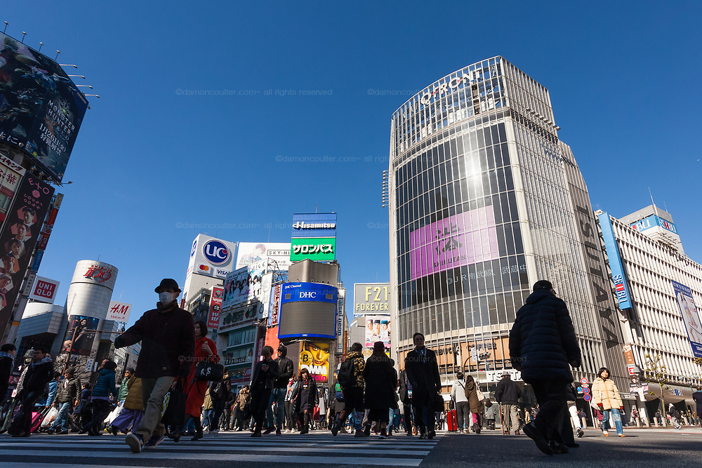 People cross the famous scramble crossing in Shibuya, Tokyo, Japan. Friday January 26th 2018