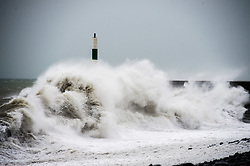 © Licensed to London News Pictures. 28/11/2018. Aberystwyth, UK. Storm Diana, with  winds gusting up to 60 or 70mph, combined with a high tide, bring huge waves battering the sea defences in Aberystwyth on the Cardigan Bay coast of west Wales. The UK Met Office has issued a yellow warning for wind today and tomorrow for western part of the British Isles, with the risk of damage to property and likely disruption to travel .Photo credit: Keith Morris/LNP