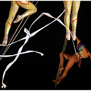 """Performers with the Cole Brothers Circus dance suspended from wires Sunday at the Pitt County Fairgrounds. (Jason A. Frizzelle) This collection of images represents more than a decade of work at newspapers and wire services throughout North Carolina. I now practice my style of story-telling photography for weddings community events as well as portrait sessions ranging from brides to local authors. After graduating from Randolph Community College I spent more than a decade documenting communities throughout Eastern North Carolina with a camera. My passion for capturing story-telling images has allowed me to witness everything from High School Football to Hurricanes and even Presidential visits.<br /> <br /> My award-winnng photography has been published internationally, appearing in publications such as The Atlanta Journal Constitution, The Los Angeles Times, USA Today, The Guardian of London, and Time Magazine.<br /> <br /> As a child I loved the writing of Ray Bradbury, who was often noted for """"tuning the ordinary into the extraordinary."""" That's the approach I take to every assignment, finding the priceless moments in everyday life. Weather I'm capturing a high school touchdown celebration or a bride's final minutes before saying """"I do,"""" I'm preserving an extraordinary memory.<br />             <br /> Whether I'm documenting a diverse community or capturing a couple's first dance, I'm photographing something extraordinary!"""