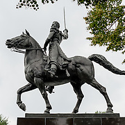 A large statue of Venezuelan leader Simon Bolivar, by Felix de Weldon, that stands in a park in front of the Interior Department in Foggy Bottom in northwest Washington DC. The statue was installed as a gift of the Venezuelan Government in 1955 and is formally titled Equestrian of Simon Bolivar.