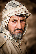 An Afghan emerald miner outside of a mine in the mountains above the Panjshir River Valley.