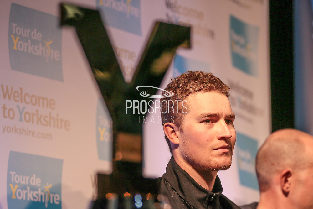 Scott Thwaites (Dimension Data) answers questions with the trophy at one side of the stage during the Tour de Yorkshire Press Conference at the National Railway Museum, York, United Kingdom on 27 April 2017. Photo by Mark P Doherty.