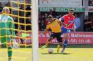 Newport's Ryan Jackson (c) powers into the box past Dagenham's Joseph Widdowson. Skybet football league two match , Newport county v Dagenham & Redbridge at Rodney Parade in Newport, South Wales on Saturday 18th April 2015.<br /> pic by David Richards, Andrew Orchard sports photography.
