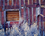 Pattern of flattened square cans protecting seams in wood slat building, ghost town of Belmont founded in the 1860s and supported by silver mining, Toquima Range, Nevada.