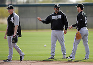 GLENDALE, AZ - FEBRUARY 24:  Manager Ozzie Guillen #13 talks to Jayson Nix #5 as Gordon Beckham #15 of the Chicago White Sox looks on during a workout on February 24, 2010 at the White Sox training facility at Camelback Ranch in Glendale, Arizona. (Photo by Ron Vesely)